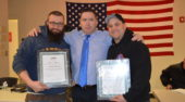 Bob Butler and Dan Hardy present certificates to SMW who stepped up and helped in times of need.